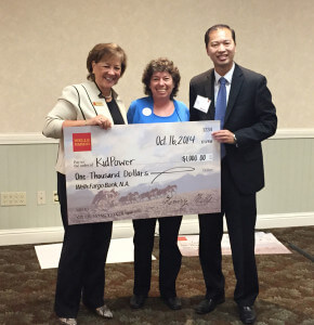 Irene receiving a BIG check from Wells Fargo's Sandi Eason, Senior Vice President of Business Banking, and Max Seetho, Vice President and Manager, Santa Cruz District