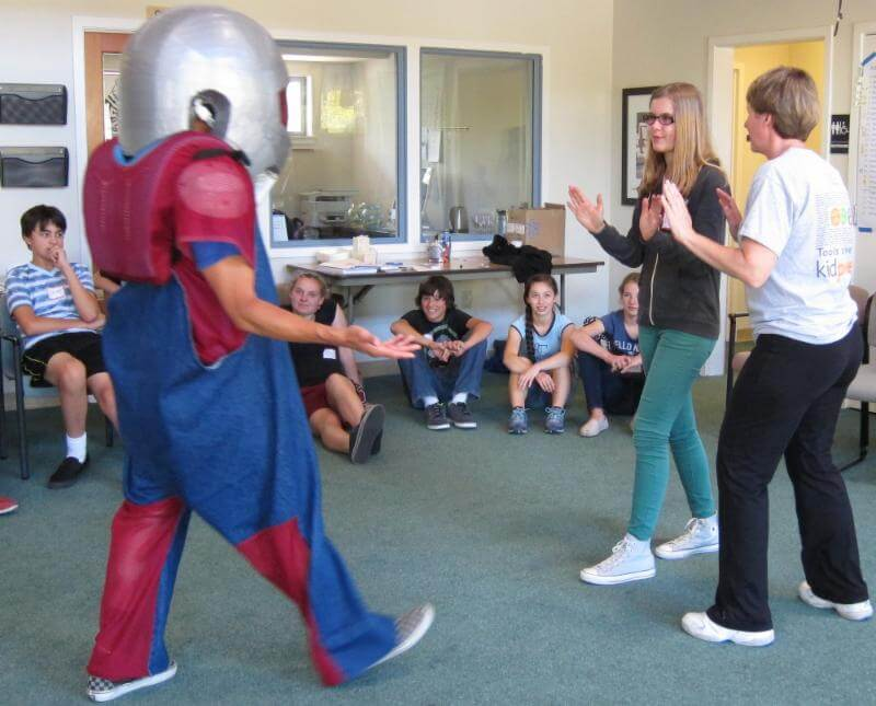 """Practicing physical self-defense with """"full-force"""" padded instructor."""