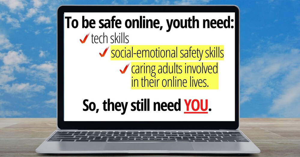 Laptop with online safety tips on screen