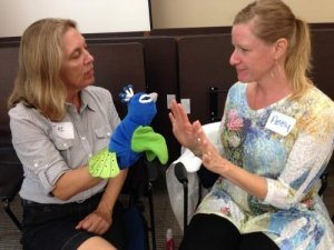 Practice teaching boundary setting role-plays with puppets to engage younger children.