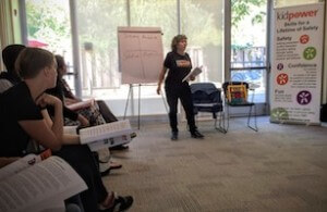 Photo of Irene teaching a child protection workshop for professionals