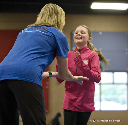 Photo of a tween practicing safety skills in a Kidpower workshop.