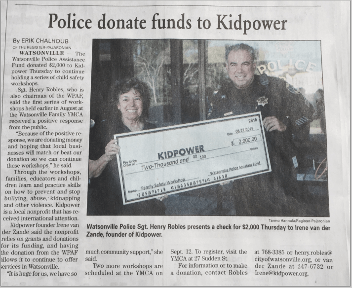 Newspaper clipping image - Watsonville Police donate funds to Kidpower article. Published 29Aug2015 in the Register-Pajaronian