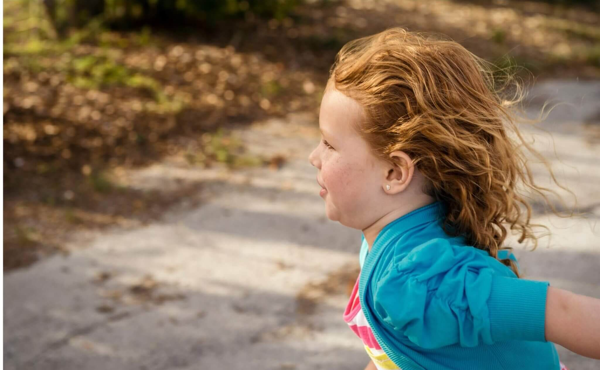 young child outside running to safety