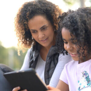 Parent and child practicing online safety
