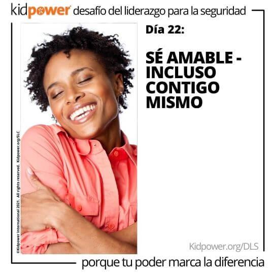 Mujer feliz abrazándose a sí misma. Texto: Día 22: Sé amable - Incluso contigo mismo #KidpowerDLS