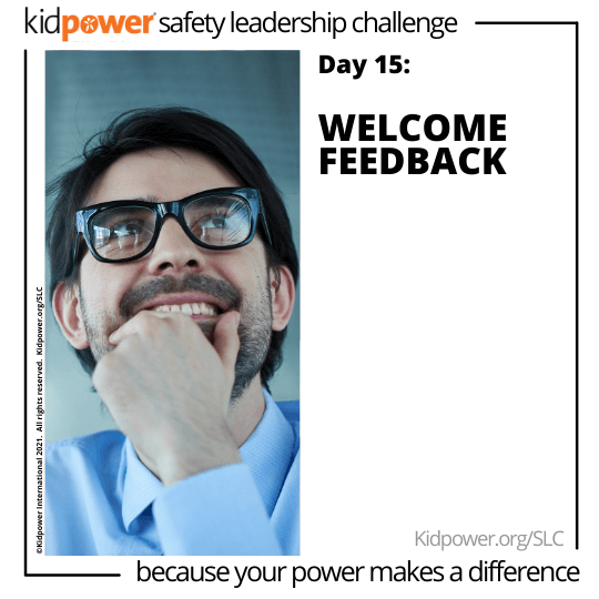 Businessman holding chin and smiling. Text: Day 15: Welcome Feedback #KidpowerSLC