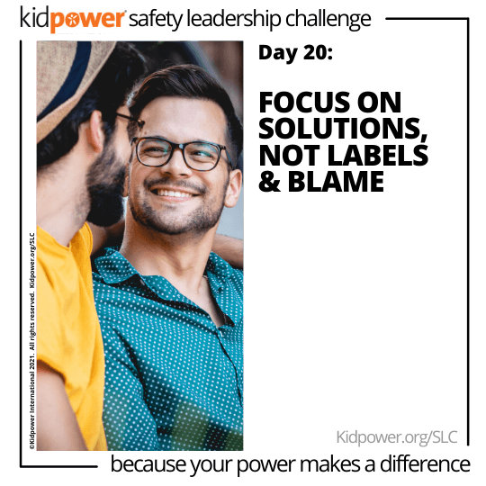 Two young men looking at each other, smiling. Text: Day 20: Focus On Solutions, Not Labels & Blame #KidpowerSLC