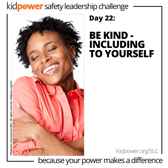 Happy woman hugging herself. Text: Day 22: Be Kind - Including to Yourself #KidpowerSLC