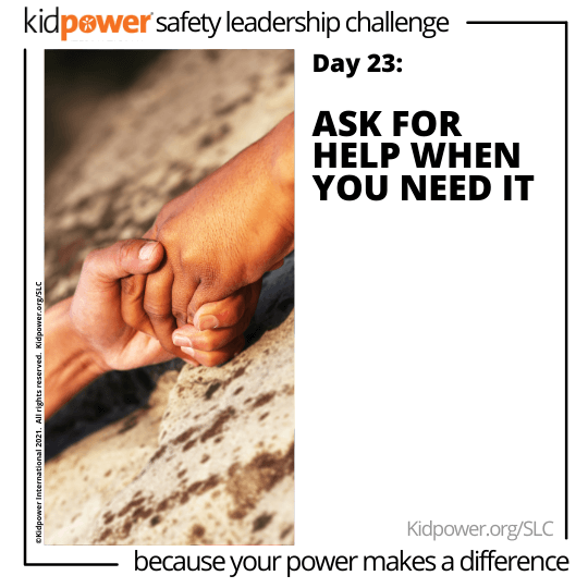 Two people holding hands on rock. Text: Day 23: Ask For Help When You Need It #KidpowerSLC