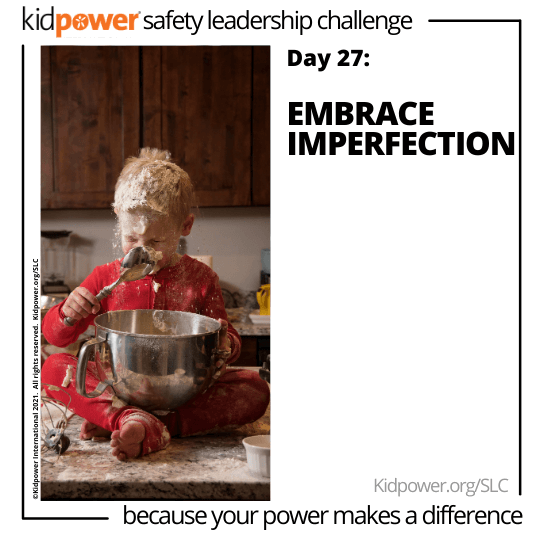 Toddler with bowl making a mess in kitchen. Text: Day 27: Embrace Imperfection #KidpowerSLC