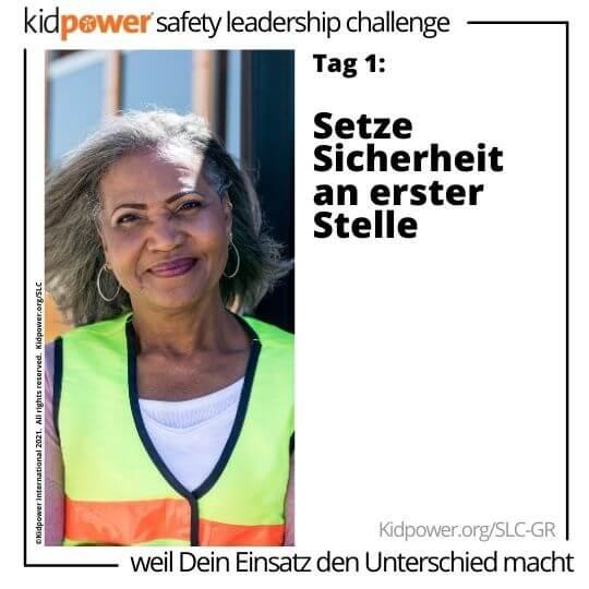 Erwachsene Frau Crossing Guard lächelnd. Text: Tag 1: Setze Sicherheit an erster Stelle #KidpowerSLCGR